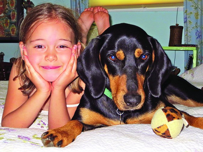 girl and coonhound
