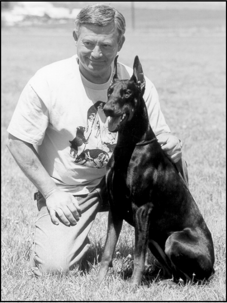 Ray Carlisle and Doberman